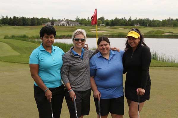 4 ladies golfing