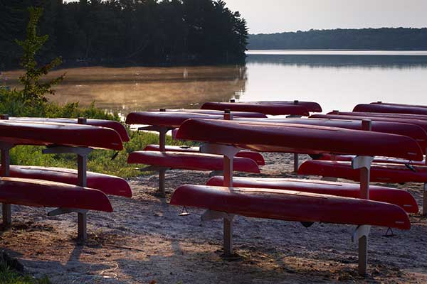 Stored Canoes on lakefront