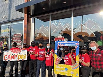 Volunteers posing for photo outside Tim Hortons Restaurant